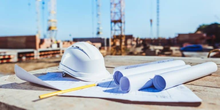 Hard Hat and Floor Plans at Construction Site