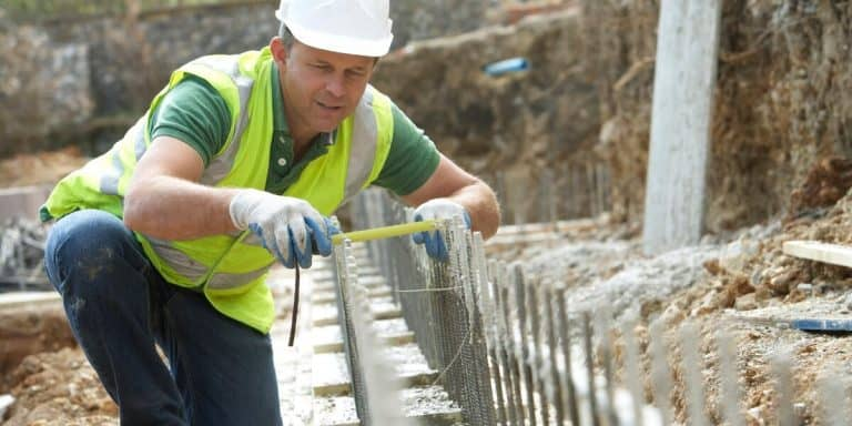 Builder Laying Foundation